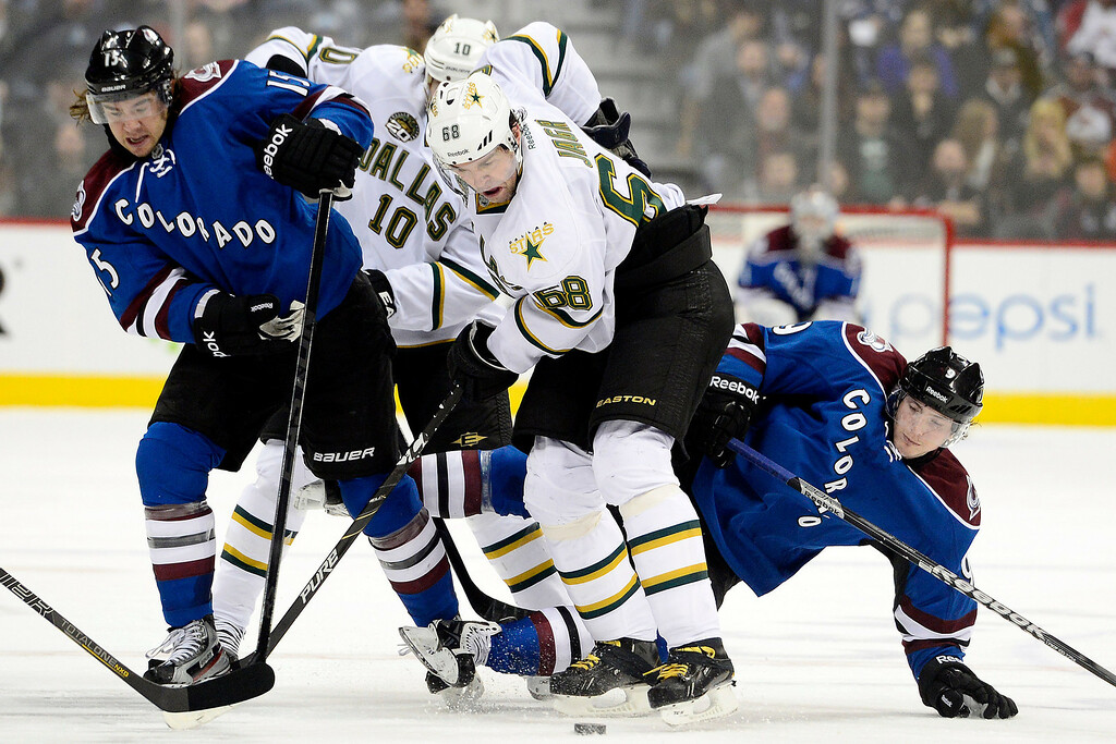 . DENVER, CO. - FEBRUARY 4: Jaromir Jagr (68) of the Dallas Stars controls the puck as he competes with P.A. Parenteau (15) of the Colorado Avalanche and Matt Duchene (9) during the third period of Dallas\'s 3-2 win. Colorado Avalanche versus the Dallas Stars at the Pepsi Center on February 4, 2012. (Photo By AAron Ontiveroz/The Denver Post)