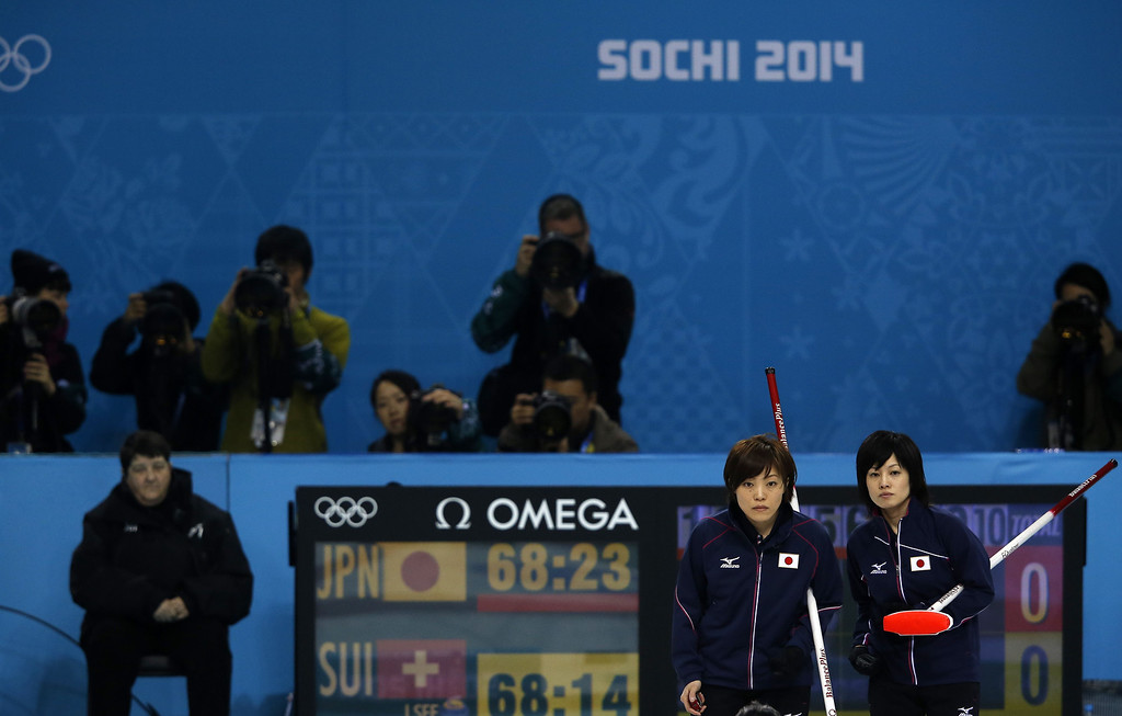 . Japan\'s Skip Ayumi Ogasawara (2nd R) and Yumie Funayama (R) look on during the women\'s curling round robin session 10 match between Japan and Switzerland at the Ice Cube curling centre in Sochi on February 16, 2014 during the 2014 Sochi winter Olympics. AFP PHOTO / ADRIAN DENNISADRIAN DENNIS/AFP/Getty Images