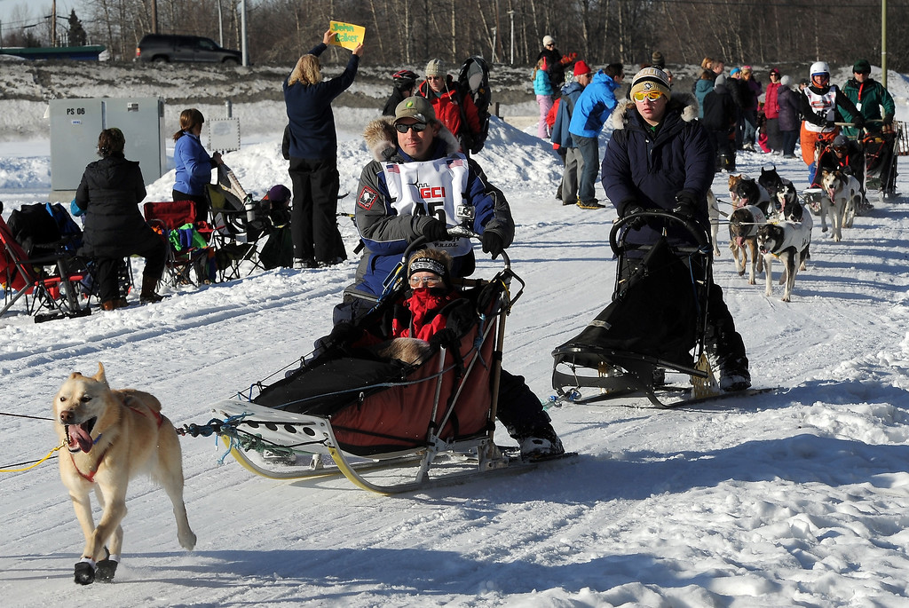 . John Dixon of Fairbanks, Alaska, is chased along the Chester Creek trail by Cindy Abbott of Irvine, Calif., during the ceremonial start for the 2014 Iditarod Trail Sled Dog Race on Saturday, March 1, 2014, in Anchorage, Alaska. (AP Photo/The Anchorage Daily News, Erik Hill)