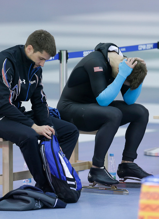 . U.S. speed skater Joey Mantia, right, holds his head after the men\'s 1500-meter race at the Adler Arena Skating Center at the 2014 Winter Olympics, Saturday, Feb. 15, 2014, in Sochi, Russia. U.S. skaters are looking to bounce back from an awful start to their Olympics by slipping back into their old suits that should have been made obsolete by new high-tech gear. (AP Photo/Patrick Semansky)