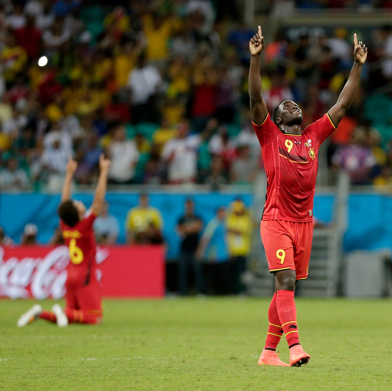 . Belgium\'s Romelu Lukaku celebrates after Belgium defeated the USA 2-1 in extra time to advance to the quarterfinals during the World Cup round of 16 soccer match between Belgium and the USA at the Arena Fonte Nova in Salvador, Brazil, Tuesday, July 1, 2014. Lukaku scored his side\'s second and winning goal. (AP Photo/Marcio Jose Sanchez)