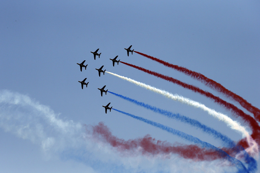". Jets from the French Air Force precision flying team ""La Patrouille de France\"" perform above Porto-Vecchio to mark the start of the 213 km first stage of the 100th edition of the Tour de France cycling race on June 29, 2013 between Porto-Vecchio and Bastia, on the French Mediterranean Island of Corsica.  AFP PHOTO / JOEL SAGET/AFP/Getty Images"