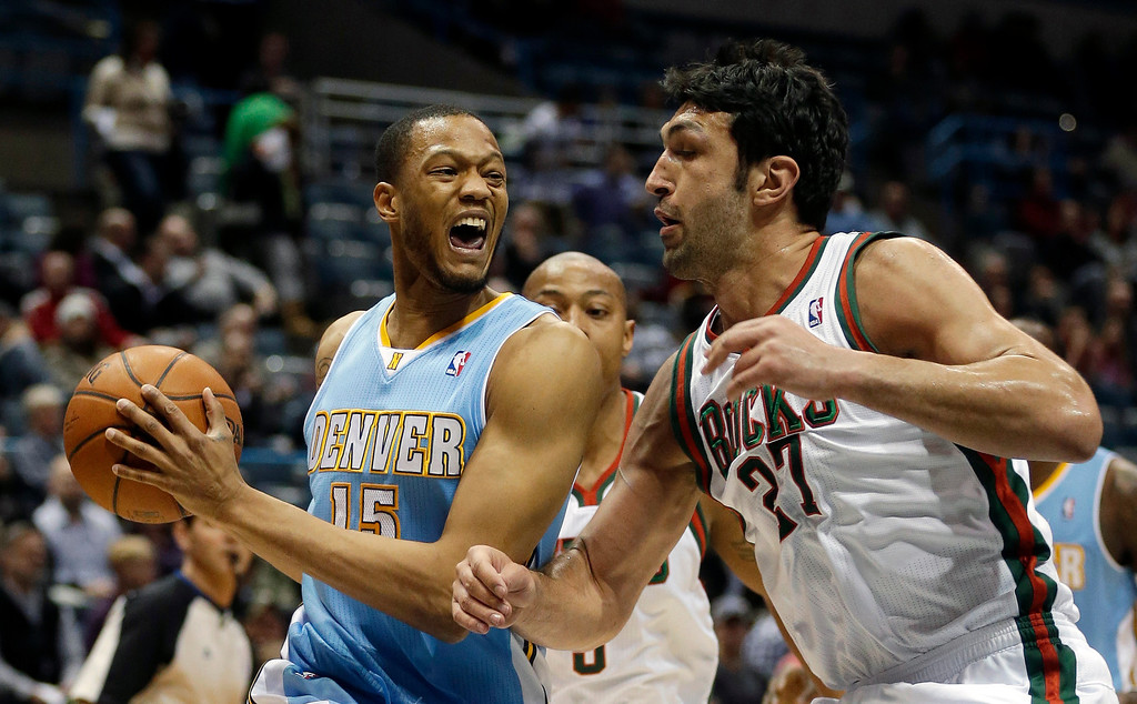 . Denver Nuggets\' Anthony Randolph (15) drives against Milwaukee Bucks\' ZaZa Pachulia, right, during the first half of an NBA basketball game Thursday, Feb. 20, 2014, in Milwaukee. (AP Photo/Jeffrey Phelps)