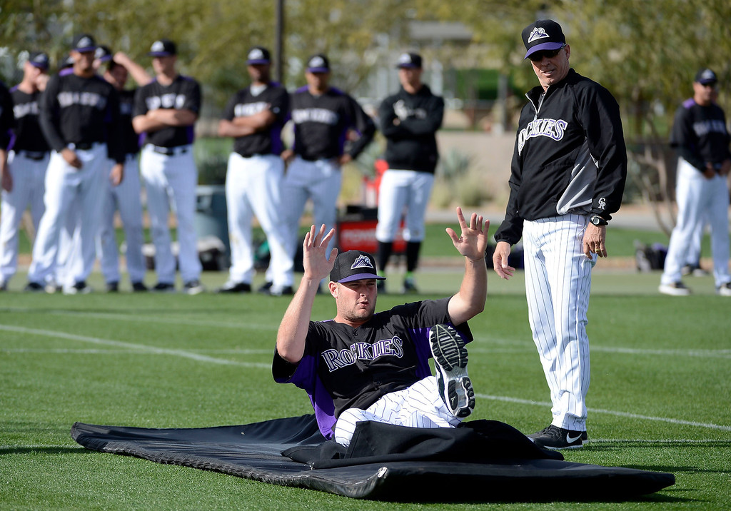. SCOTTSDALE, AZ. - FEBRUARY 19: Colorado Rockies Chris Volstad (31) practices his sliding technique during Spring Training February 19, 2013 in Scottsdale. (Photo By John Leyba/The Denver Post)