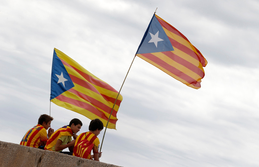 . Youths hold Independentist Catalan flags as part of a campaign for independence from Spain during Catalonia National Day, or Diada, in Alcanar, on September 11, 2013. Independence-seeking Catalans  marshalled their forces today to make a human link they say will stretch across 86 cities, towns and villages along the coast of the northeastern region on the Mediterranean, passing landmarks such as the Sagrada Familia basilica in Barcelona and the city\'s Camp Nou football stadium. JOSE JORDAN/AFP/Getty Images