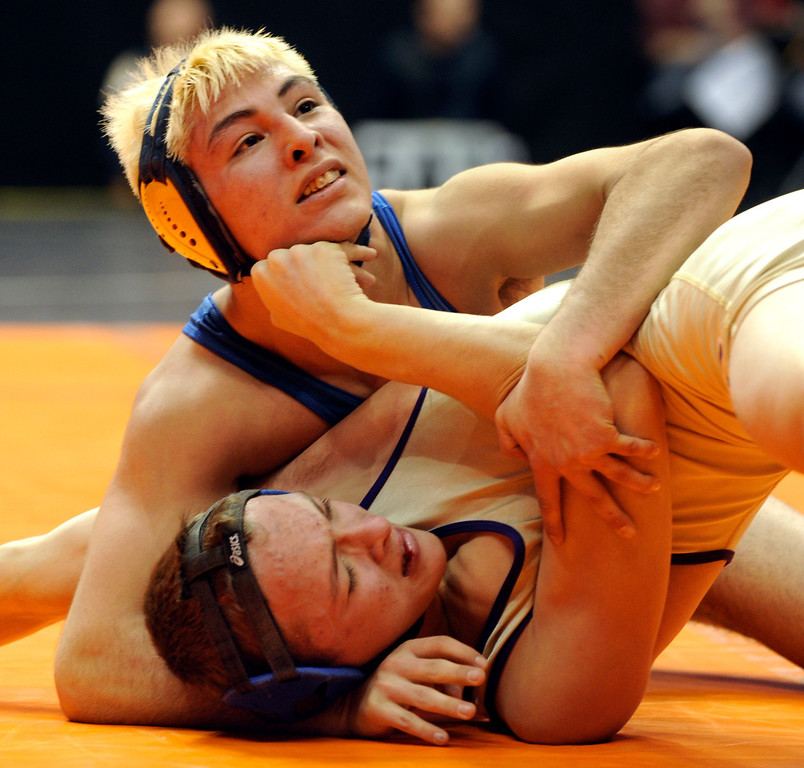 . DENVER, CO. - FEBRUARY 21: Sheridan High School senior Levi Maes, top, struggled with Holy Family sophomore Julian Prieto, bottom, during a class 3A, 120-pound semifinal bout Friday night. Maes defeated Prieto 16-7 to advance to the finals Saturday night. The CHSAA State Wrestling Tournament continued Friday, February 22, 2013 with quarterfinal and semifinal matches at the Pepsi Center in Denver. (Photo By Karl Gehring/The Denver Post)