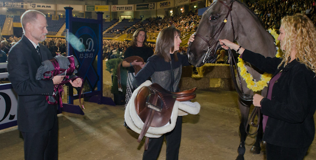 . Claire Davis\' horse trainer Rebecca Johnson, right, holds the reins of Claire\'s horse Graphite as her mother Desiree takes the saddle and pets the horse during the celebration of life service for Arapahoe High School shooting victim Claire Esther Davis held at the National Western Stock Show Event Center in Denver, Co on January 1, 2014.   (Photo by Robert D. Tonsing/Courtesy of the Davis Family)