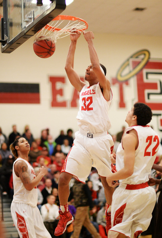 . DENVER, CO. JANUARY 24: Tyre Robinson of East High School (32) dunks during the 2nd half of the game against Thomas Jefferson High School at East High School in Denver, Colorado January 24, 2014. East High School won 91-62. (Photo by Hyoung Chang/The Denver Post)
