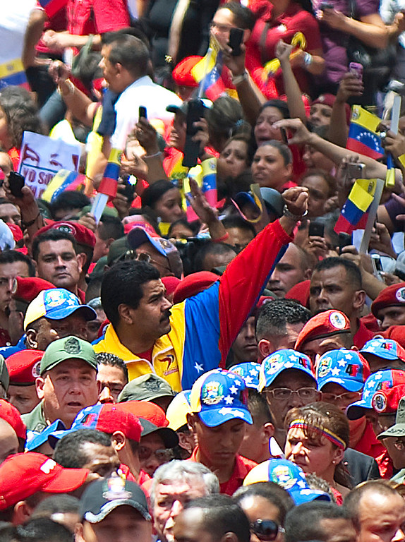 . Venezuelan acting President Nicolas Maduro (C) raises his fist while accompanying the late Venezuelan President Hugo Chavez funeral cortege on its way to the Military Academy, on March 6, 2013, in Caracas.  AFP PHOTO/Juan  BARRETO/AFP/Getty Images