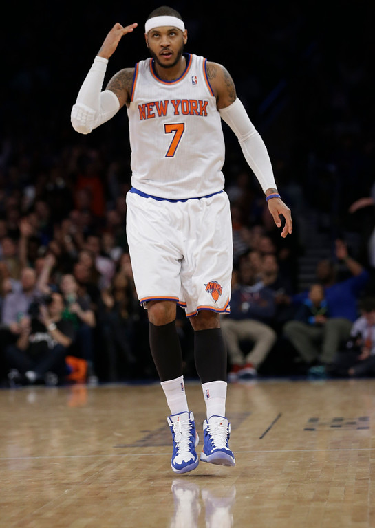 . New York Knicks\' Carmelo Anthony gestures after making a 3-point basket during the first half of an NBA basketball game against the Denver Nuggets on Friday, Feb. 7, 2014, in New York. The Knicks won 117-90. (AP Photo/Frank Franklin II)