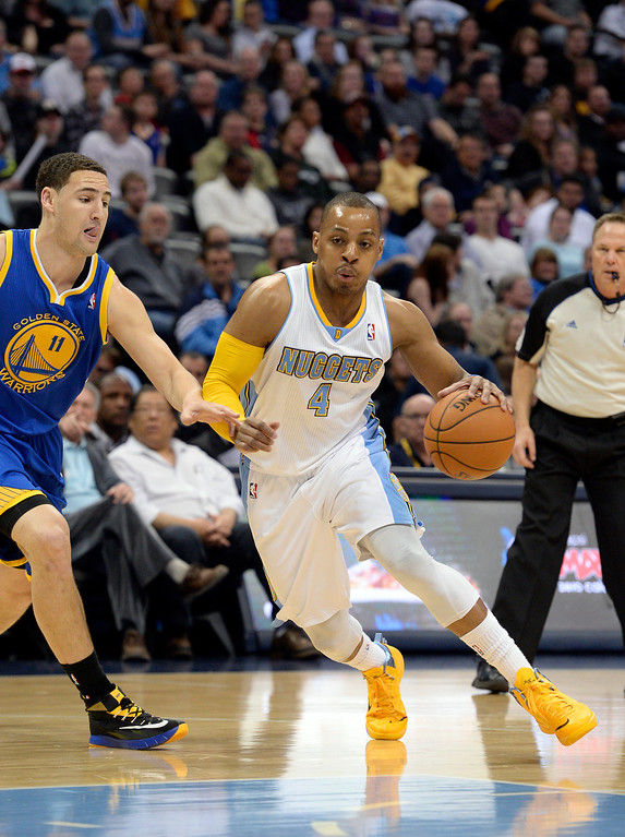 . DENVER, CO - APRIL 16: Denver Nuggets guard Randy Foye (4) drives to the basket past by Golden State Warriors guard Klay Thompson (11) during the first quarter April 16, 2014 at Pepsi Center. (Photo by John Leyba/The Denver Post)
