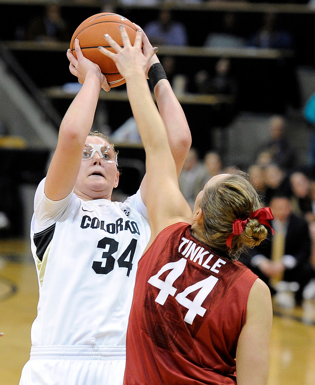 . University of Colorado\'s Jen Reese takes a shot over Joslyn Tinkle during a game against Stanford on Friday, Jan. 4, at the Coors Event Center on the CU campus in Boulder.    Jeremy Papasso/Camera