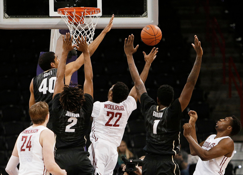 . Washington Stateís Royce Woolridge (22) attempts a layup while defended by Coloradoís Josh Scott (40) and Xavier Johnson (2) during the first half of an NCAA college basketball game Wednesday, Jan. 8, 2014, in Spokane, Wash. (AP Photo/Young Kwak)