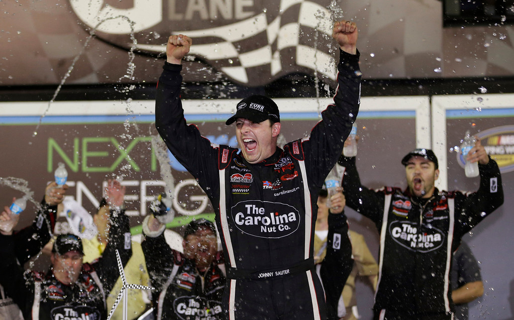 . Johnny Sauter, center, celebrates with crew members in Victory Lane after winning the NASCAR Truck Series auto race at Daytona International Speedway, Friday, Feb. 22, 2013, in Daytona Beach, Fla. (AP Photo/John Raoux)