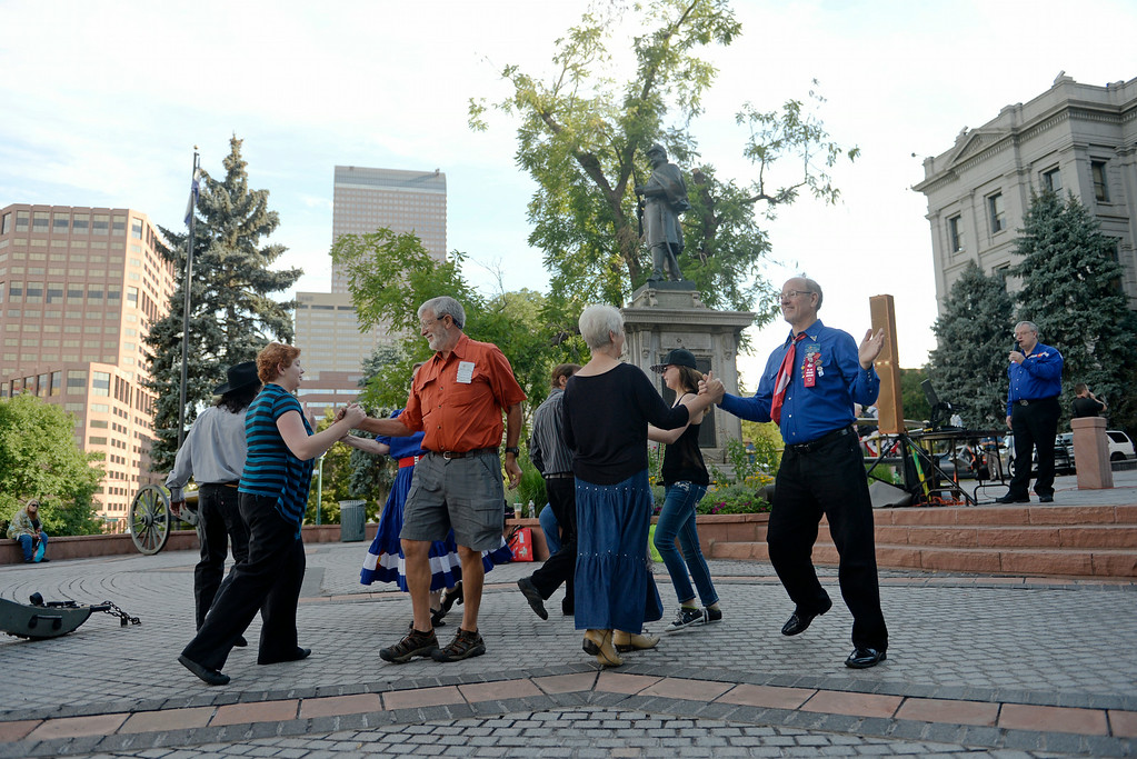 . Members of the Colorado State Square Dance Association show off their moves as they celebrate 138th anniversary of the state of Colorado on the west steps of Colorado State Capitol in Denver, August 01, 2014. The celebration included dancing, a cake, a performance from the Colorado Army National Guard Band, and more. (Photo by RJ Sangosti/The Denver Post)