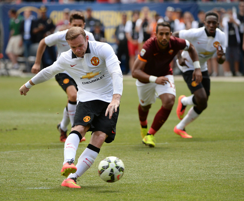 . Manchester United striker Wayne Rooney converted a penalty kick late in the first half. Manchester United took on AS Roma in an exhibition soccer game at Sports Authority Field in Denver Saturday afternoon, July 27, 2014. Photo by Karl Gehring/The Denver Post