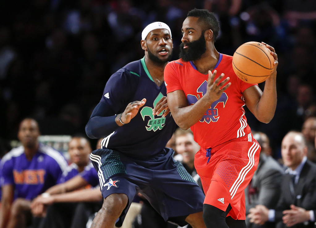 . Western Conference guard James Harden (R) drives against Eastern Conference forward LeBron James in the first half during the 63rd NBA All-Star Game in New Orleans, Louisiana.  EPA/PAUL BUCK