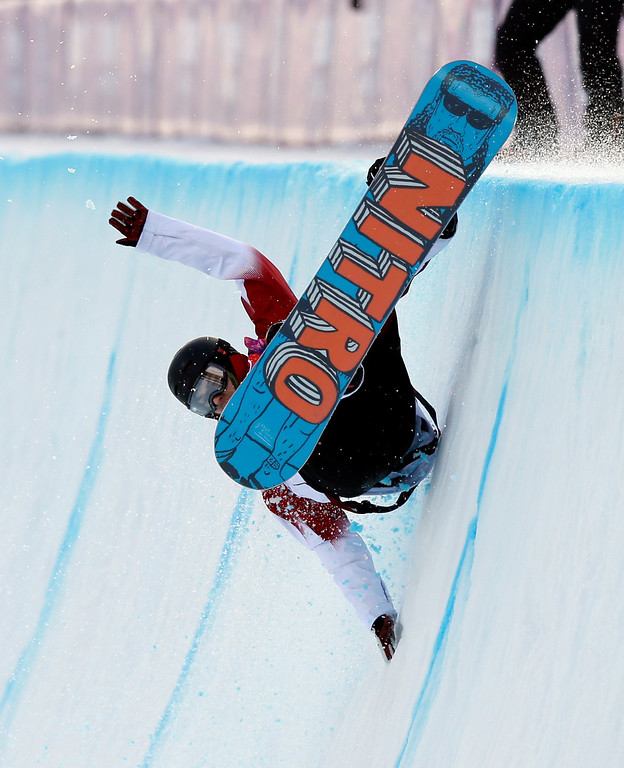 . Canada\'s Brad Martin falls during the men\'s snowboard halfpipe qualifying at the Rosa Khutor Extreme Park, at the 2014 Winter Olympics, Tuesday, Feb. 11, 2014, in Krasnaya Polyana, Russia. (AP Photo/Andy Wong)