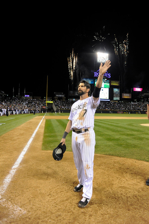Description of . Covering Helton throughout his career had its ups and downs. I made a spectacular photo of him during their win over the DiamondBacks to go to the World Series and to cap it off with his wave to the crowd on his last game at Coors Field.   DENVER, CO. - SEPTEMBER 25: Todd Helton (17) of the Colorado Rockies acknowledges the crowd with a wave after taking a lap around the field at the end of the game against the Boston Red Sox September 25, 2013 at Coors Field. Helton will retire at the end of the season after 17 years with the club. (Photo By John Leyba/The Denver Post)