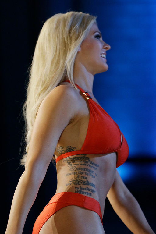 . Miss Kansas Theresa Vail shows her bathing suit during the lifestyle competition during the Miss America 2014 pageant, Sunday, Sept. 15, 2013, in Atlantic City, N.J. (AP Photo/Julio Cortez)
