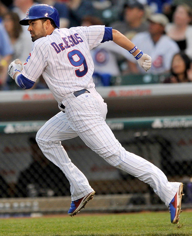 . Chicago Cubs\' David DeJesus watches his solo home run during the first inning of a baseball game against the Colorado Rockies in Chicago, Wednesday, May 15, 2013. (AP Photo/Paul Beaty)
