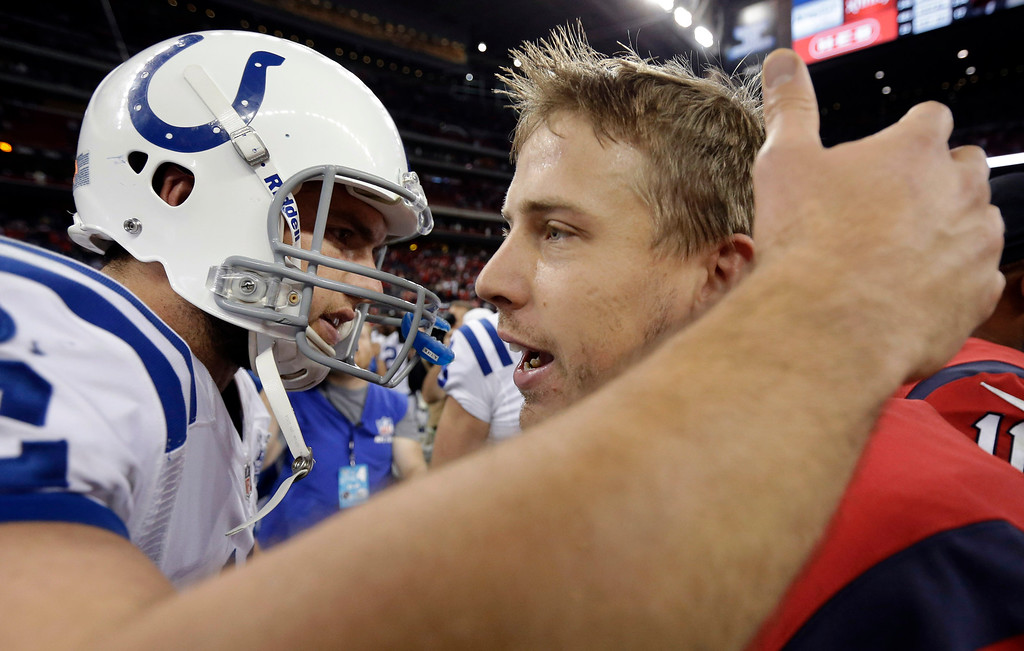 . Indianapolis Colts\' Andrew Luck, left, and Houston Texans\' Case Keenum, right, meet following an NFL football game Sunday, Nov. 3, 2013, in Houston. Indianapolis won 27-24. (AP Photo/David J. Phillip)