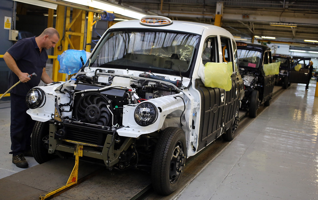 . Workers inside the factory of The London Taxi Company assemble a TX4 (Euro 5) London Taxi to its chassis on September 11, 2013 in Coventry, England.  (Photo by Matt Cardy/Getty Images)