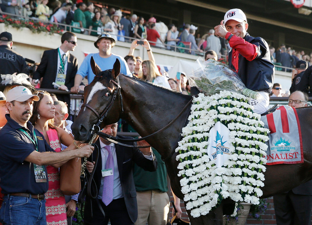 . Joel Rosario poses for photos atop Tonalist after winning the 146th running of the Belmont Stakes horse race, Saturday, June 7, 2014, in Elmont, N.Y. (AP Photo/Seth Wenig)