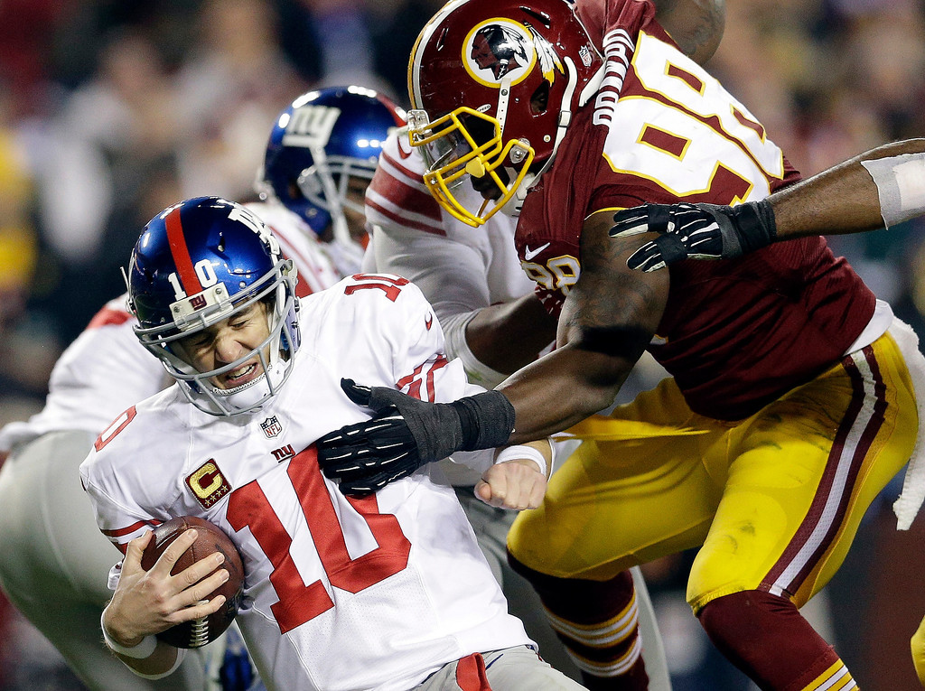 . New York Giants quarterback Eli Manning (10) is sacked by Washington Redskins outside linebacker Brian Orakpo (98) during the second half of an NFL football game Sunday, Dec. 1, 2013, in Landover, Md. (AP Photo/Patrick Semansky)