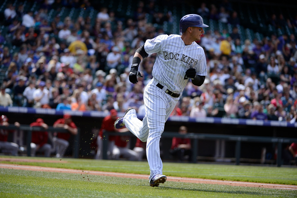 . DENVER, CO. - APRIL 21: Troy Tulowitzki (2) of the Colorado Rockies rounds first base after his single in the second inning against the Arizona Diamondbacks April 21, 2013 at Coors Field. (Photo By John Leyba/The Denver Post)