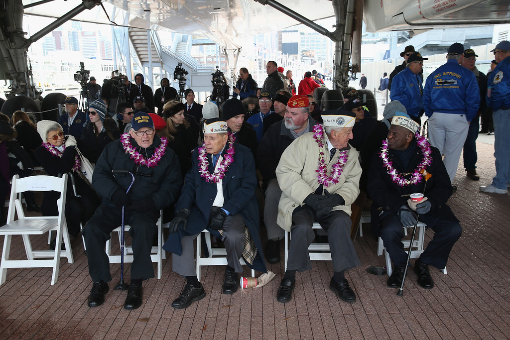 . Pearl Harbor survivors attend a ceremony marking the 72nd anniversary of the attack on Pearl Harbor, Hawaii on December 7, 2013 in New York City.  (Photo by John Moore/Getty Images)
