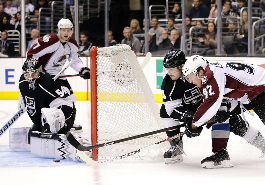 . Colorado Avalanche\'s Gabriel Landeskog(92), of Sweden, tries to score against Los Angeles Kings goalie Ben Scrivens(54) as he is defended by Los Angeles Kings\' Drew Doughty(8) during the third period of an NHL hockey game on Saturday, Nov. 23, 2013, in Los Angeles. The Avalanche won 1-0 in overtime. (AP Photo/Jae C. Hong)