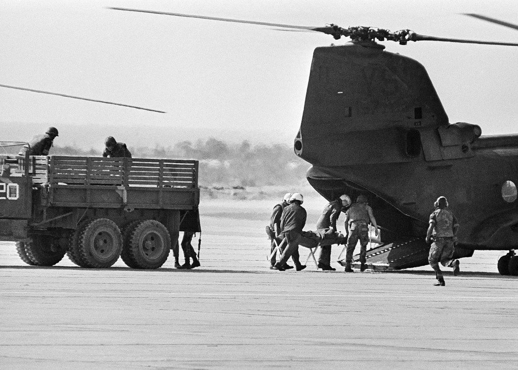 . In this Sunday, Oct. 23, 1983 file photo, a victim of a truck bomb at the U.S. Marine barracks is carried to a waiting helicopter, in Beirut, Lebanon. The blast _ the single deadliest attack on U.S. forces abroad since World War II _ claimed the lives of 241 American service members. (AP Photo/Bill Foley, File)