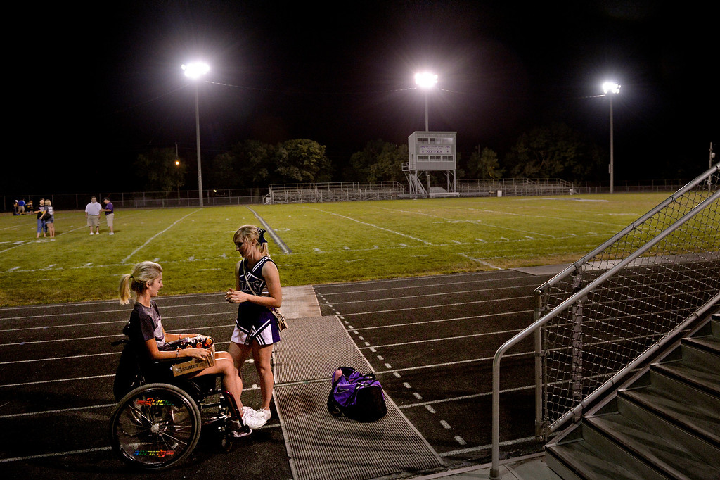 . Mackenzie, a former cheerleader and dance squad leader, was eager to leave Craig Hospital for a return to more normal life in Lake City, Iowa. She planned to join her friends as a college freshman and pursue a nursing degree; here she talks with cheerleader Stephanie Hood after their team lost a September football game. (Photo By Craig F. Walker / The Denver Post)
