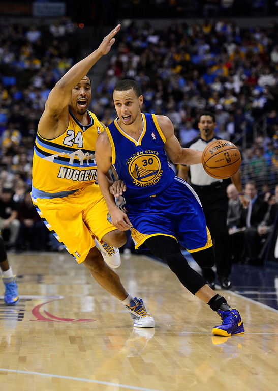 . DENVER, CO. - APRIL 23: Golden State Warriors point guard Stephen Curry (30) drives past Denver Nuggets point guard Andre Miller (24) in the second quarter. The Denver Nuggets took on the Golden State Warriors in Game 2 of the Western Conference First Round Series at the Pepsi Center in Denver, Colo. on April 23, 2013. (Photo by AAron Ontiveroz/The Denver Post)