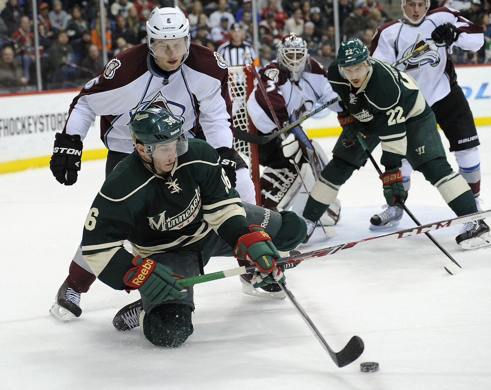 . Erik Haula #56 of the Minnesota Wild controls the puck against Erik Johnson #6 of the Colorado Avalanche during the second period of the game on November 29, 2013 at Xcel Energy Center in St Paul, Minnesota. Haula made his NHL debut as the Avalanche defeated the Wild 3-1. (Photo by Hannah Foslien/Getty Images)