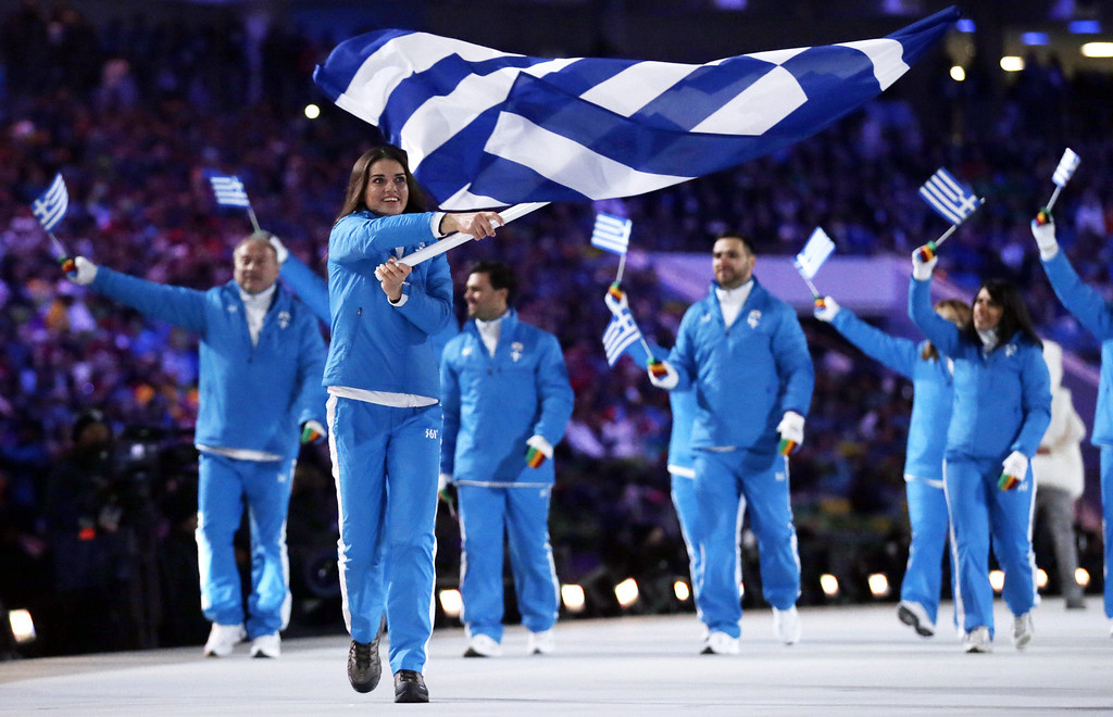 . Panagiota Tsakiri of Greece carries her countries flag during the opening ceremony of the 2014 Winter Olympics in Sochi, Russia, Friday, Feb. 7, 2014. (AP Photo/Matt Dunham)