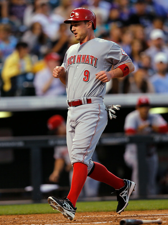 . Cincinnati Reds\' Jack Hannahan scores during the fourth inning of a baseball game against the Colorado Rockies on Friday, Aug. 15, 2014, in Denver. (AP Photo/Jack Dempsey)