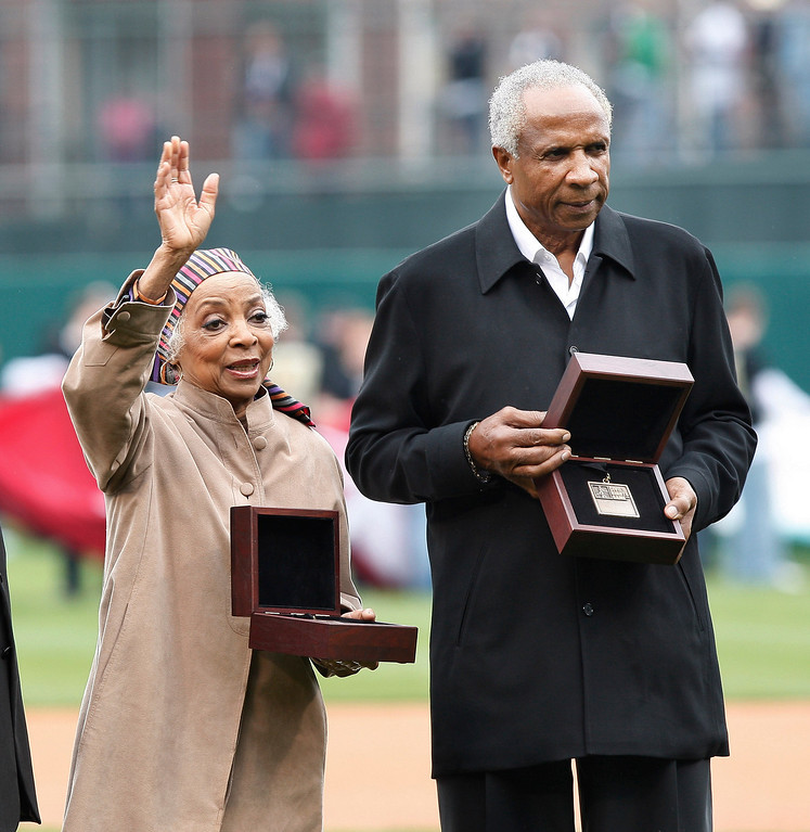 . Emmy and Grammy Award-winning actress Ruby Dee, left, and baseball Hall of Famer Frank Robinson, right, receive their Beacon Awards prior to the Civil Rights Game exhibition baseball game Saturday, March 29, 2008, in Memphis, Tenn. The Beacon Award is given, by Major League Baseball, to individuals for their efforts on behalf of civil rights throughout the world.  The late John H. Johnson, founder of Johnson Publishing, also received the honor. (AP Photo/Bill Waugh)
