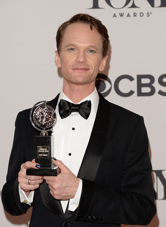 """. Neil Patrick Harris, winner of Tony Award For Best Actor In A Musical for \""""Hedwig And The Angry Inch\"""" poses in the press room during the 68th Annual Tony Awards on June 8, 2014 in New York City.  (Photo by Andrew H. Walker/Getty Images for Tony Awards Productions)"""