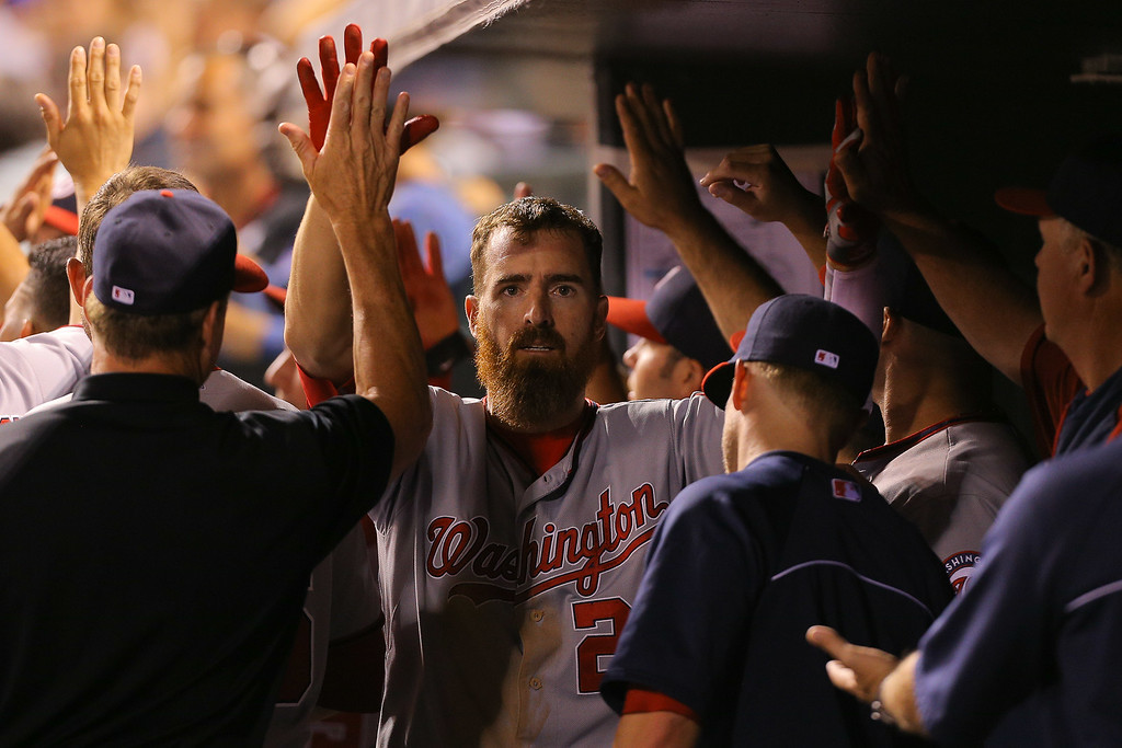 . DENVER, CO - JULY 22:  Adam LaRoche #25 of the Washington Nationals celebrates in the dugout after hitting a three run home run to give the Nationals a 7-4 lead over the Colorado Rockies in the seventh inning at Coors Field on July 22, 2014 in Denver, Colorado.  (Photo by Justin Edmonds/Getty Images)