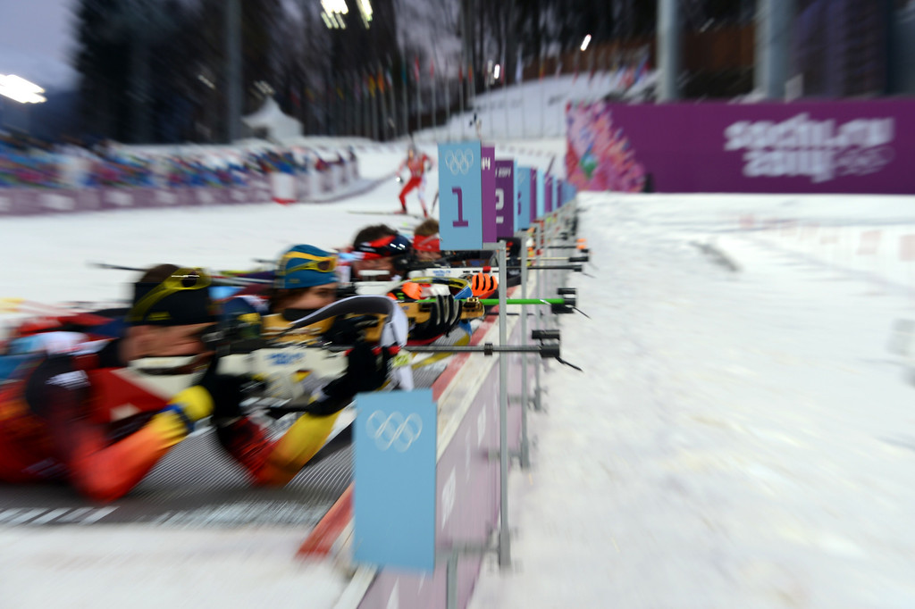 . Athletes compete at the shooting range in the Men\'s Biathlon 4x7.5 km Relay at the Laura Cross-Country Ski and Biathlon Center during the Sochi Winter Olympics on February 22, 2014, in Rosa Khutor, near Sochi.  KIRILL KUDRYAVTSEV/AFP/Getty Images