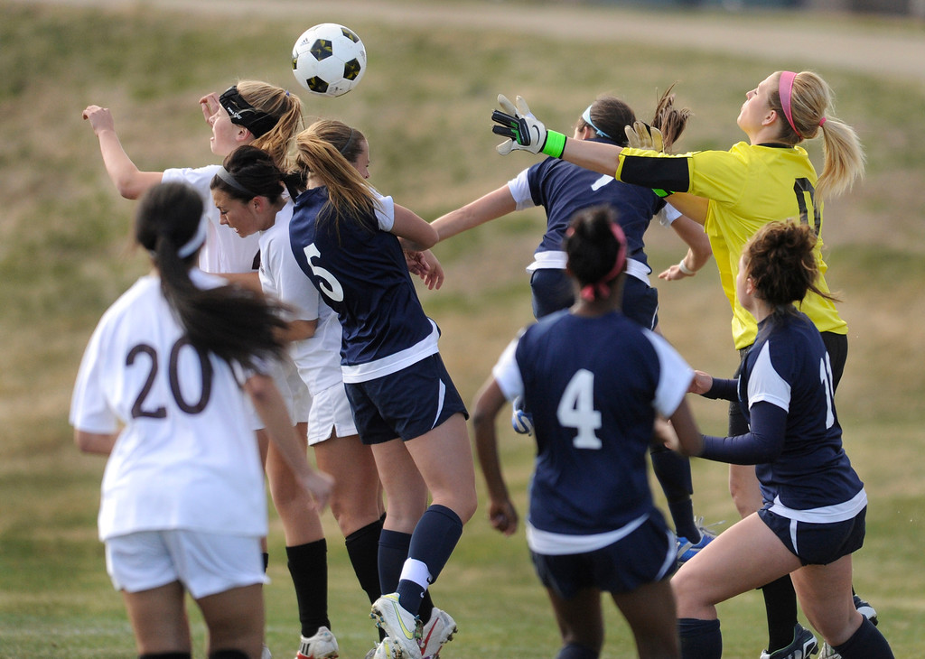 . PARKER, CO. - APRIL 2: Golden goalkeeper Jordyn Komoras (0) came out of the net to punch away an attempt by Valor in the first half. The Valor Christian High School girl\'s soccer team defeated Golden 4-1 Wednesday night, April 3, 2013.  Photo By Karl Gehring/The Denver Post)