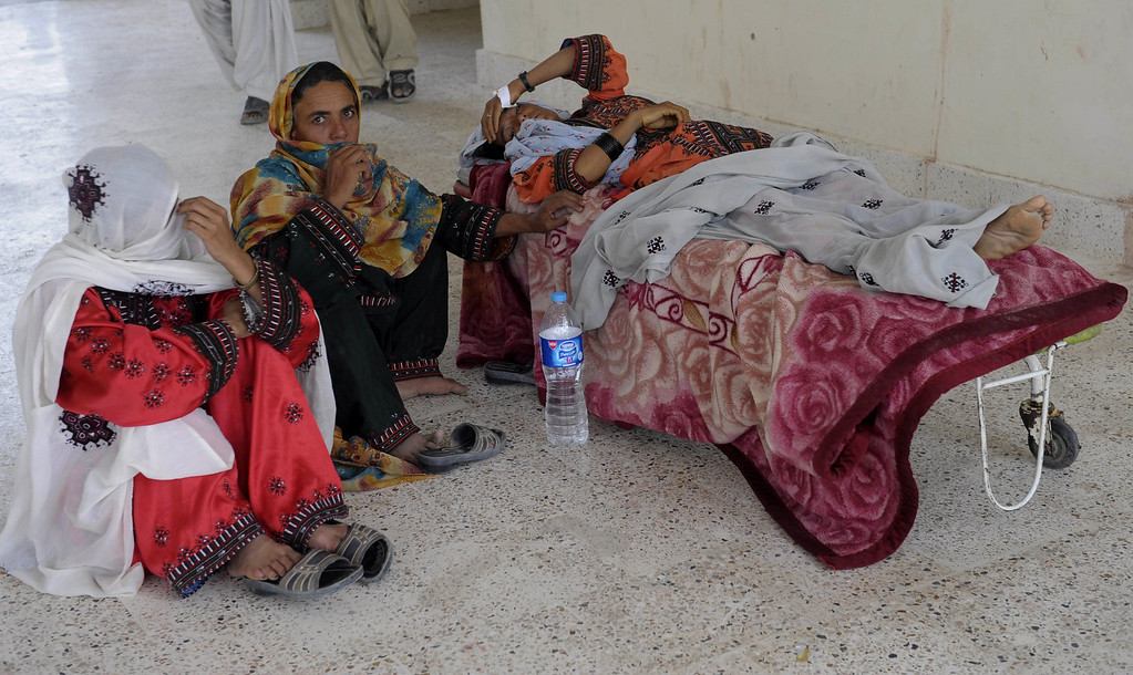 . Pakistani earthquake survivors sit with an injured relative as they wait for transport to another hospital in the devastated district of Awaran on September 28, 2013. A powerful 6.8-magnitude earthquake hit southwest Pakistan, killing at least 22 people in a region already devastated by a tremor which left more than 300 people dead this week, local officials said. BANARAS KHAN/AFP/Getty Images