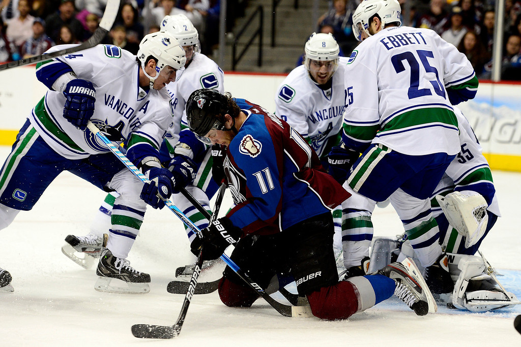 . DENVER, CO - MARCH 24: Jamie McGinn (11) of the Colorado Avalanche plays near the crease from his knees against the Vancouver Canucks during the third period of action. The Colorado Avalanche lost to the Vancouver Canucks 3-2 at the Pepsi Center. (Photo by AAron Ontiveroz/The Denver Post)