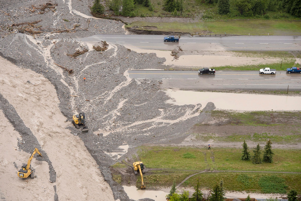 . This aerial photo shows crews working on the washed out Trans-Canada Highway in Canmore, Alberta, Canada, on Friday June 21, 2013. (AP Photo/The Canadian Press, Jonathan Hayward)