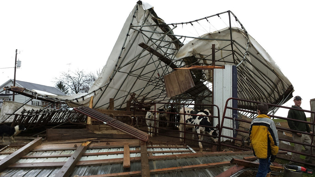 . In a photo provided by Dodge County Emergency Management, a cattle shed on a family farm in the Town of Hustisford, Wis., is damaged Sunday, Nov. 17, 2013, after severe weather moved through the area. Dodge County Emergency Management Director Joseph Meagher says no cattle were injured. (AP Photo/Dodge County Emergency Management, Joseph Meagher)