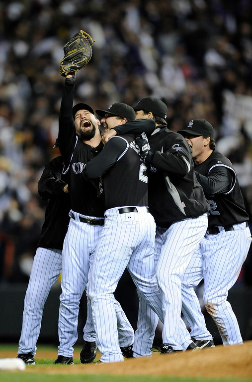 . Todd Helton celebrates the win with his teammates in game Four of the National League Championship series between the Colorado Rockies and Arizona Diamondbacks at Coors Field.  The Denver Post,  John Leyba