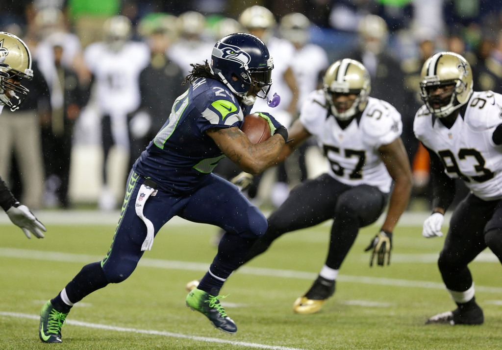 . Seattle Seahawks running back Marshawn Lynch (24) runs against the New Orleans Saints in the first half of an NFL football game, Monday, Dec. 2, 2013, in Seattle. (AP Photo/Elaine Thompson)