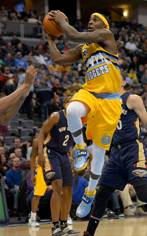 . Denver Nuggets guard Ty Lawson (3) drives to the basket during the fourth quarter against the New Orleans Pelicans April 2, 2014 at the Pepsi Center in Denver. The Denver Nuggets defeated the New Orleans Pelicans 137-107. (Photo by John Leyba/The Denver Post)